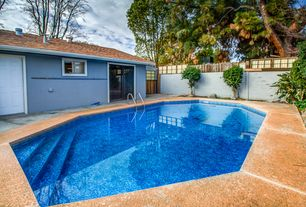 Contemporary Swimming Pool with exterior stone floors, Fence