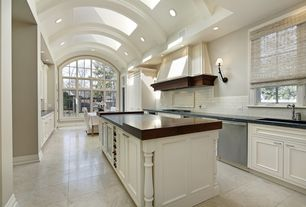 Transitional Kitchen With Flat Panel Cabinets, Wood Counters, Limestone  Tile Floors, Kitchen Island