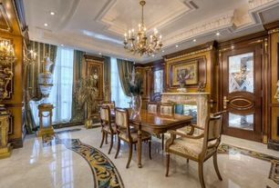 Traditional Dining Room With Chandelier, High Ceiling, Crown Molding,  Wainscoting, Metal Fireplace
