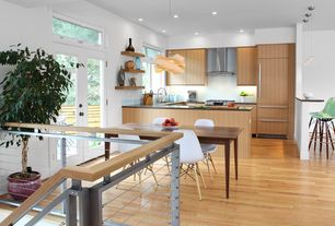 Modern Kitchen With Eames Molded Fiberglass Stool, Towson Greenlam  Cabinets, Link Suspension Light