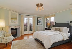 Traditional Master Bedroom With Hardwood Floors Crown Molding Metal Fireplace High Ceiling