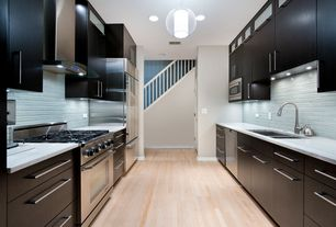 5 Tags Contemporary Kitchen With Galley Kitchen, Laminate Floors, Designer  White Solid Surface Countertop, Corian