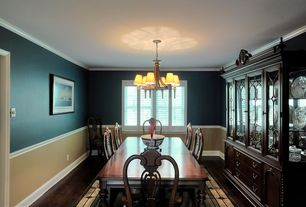Traditional Dining Room With Chandelier Built In Bookshelf Crown Molding Chair Rail
