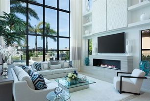 modern living room with high ceiling built in bookshelf carpet travertine tile