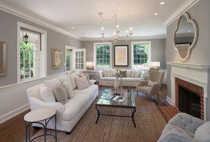 Traditional Living Room With Hardwood Floors Chandelier Cala Small Quatrefoil Global Coastal Cream Wall
