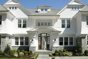 traditional exterior of home with partial stone exterior transom window pathway - Luxury Stone Exterior
