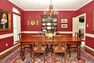 Traditional Dining Room With Chair Rail, Specialty Door, Crown Molding,  Hardwood Floors,