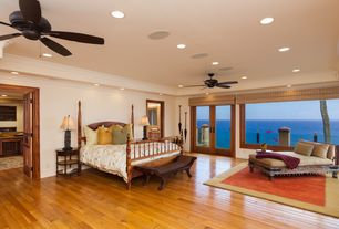 1 tag tropical master bedroom with crown molding carpet ceiling fan hardwood floors high
