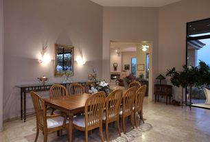 Contemporary Dining Room With Travertine Tile Floors, Wall Sconce