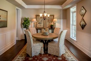Traditional Dining Room With High Ceiling Pendant Light Hardwood Floors Wainscoting Carpet