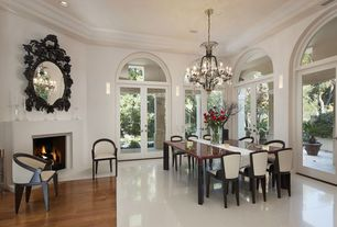 Transitional Dining Room With Chandelier High Ceiling Cement Fireplace Hardwood Floors Limestone