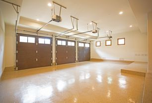 garage with concrete floors flush light high ceiling