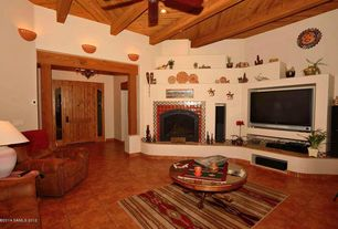 1 Tag Southwestern Living Room With Stone Fireplace, Ceiling Fan, Exposed  Beam, Wall Sconce,