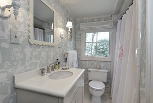 Traditional Full Bathroom with Designer White Solid Surface Countertop,  Corian, Wall sconce, Limestone