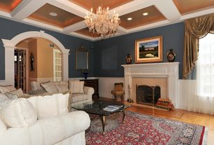 Contemporary Living Room With Cement Fireplace Wainscoting Chair Rail Crown Molding Chandelier