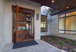 modern front door with exterior tile floors pathway in