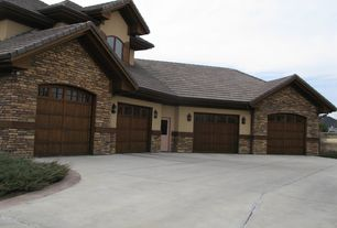 Garage Design Ideas Pictures find this pin and more on garage ideas interior design 4 Tags Traditional Garage With Carriage Door Classic Line Eldorado Stone Romabrick High Ceiling
