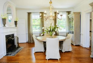 Traditional Dining Room With High Ceiling Stone Fireplace Hardwood Floors Chair Rail