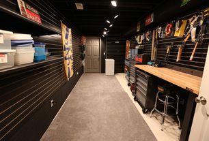 Modern Garage With Built In Bookshelf, Flush Light, Carpet, Concrete Floors