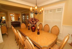 Traditional Dining Room With Crown Molding Carpet Chandelier Wainscoting