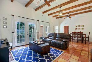 Southwestern Living Room With Carpet, Exposed Beam, Ceiling Fan, Pendant  Light, Terracotta