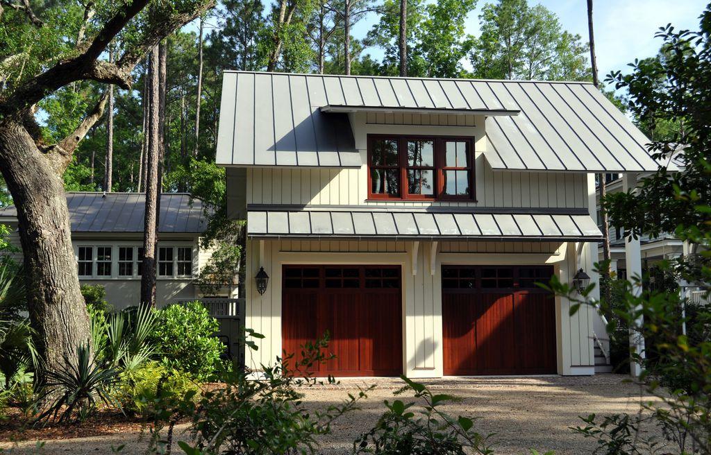 Craftsman Garage With Concrete Floors, Wall Sconce, Barn Door, Skyline  Metal Roofing,