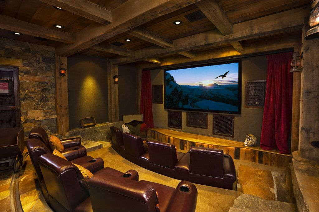 Rustic Home Theater with Wall sconce by Locati Architects