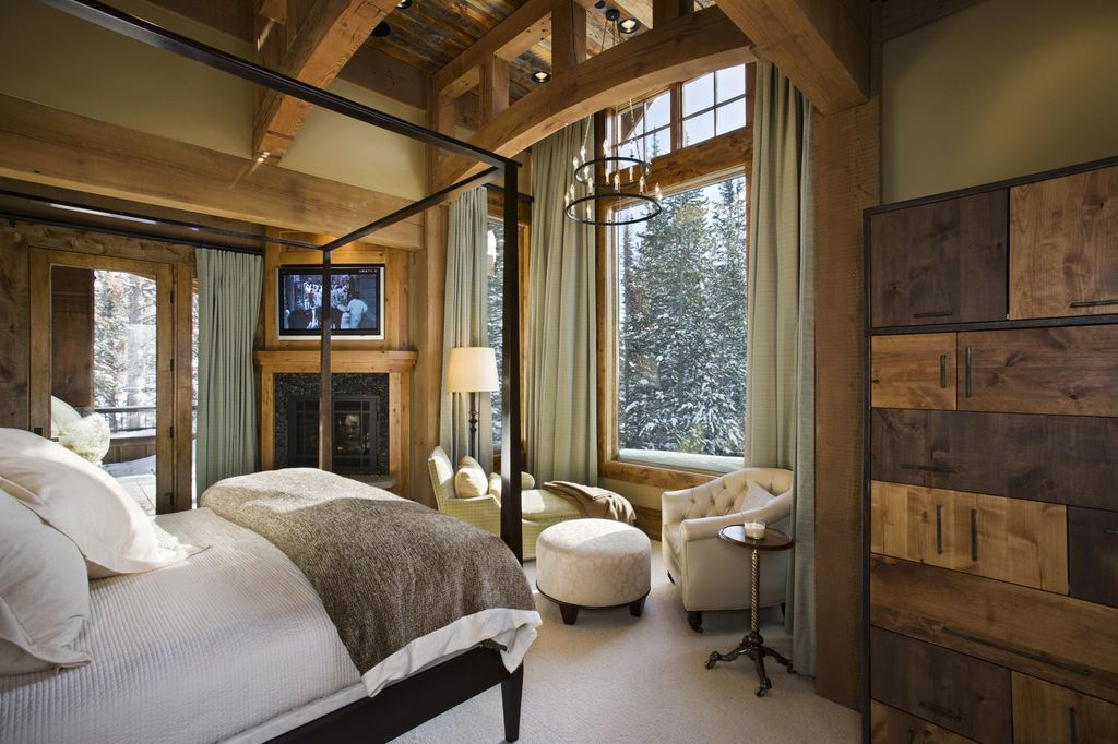 rustic master bedroom with chandelier by locati architects