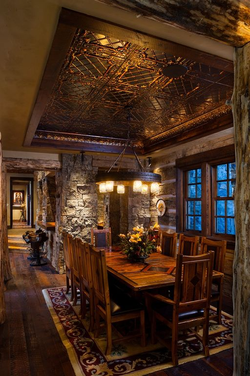 Rustic Dining Room With Hardwood Floors By