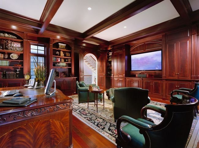 traditional home office with laminate floors exposed beam crown molding built in