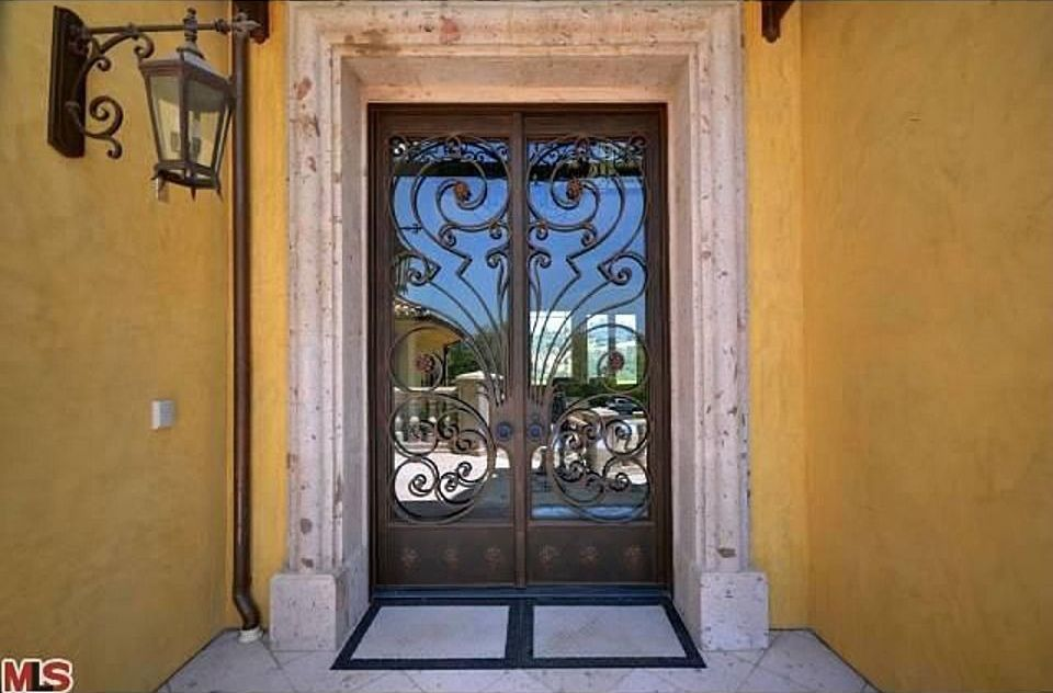 Mediterranean front door with exterior tile floors for Front entry french doors