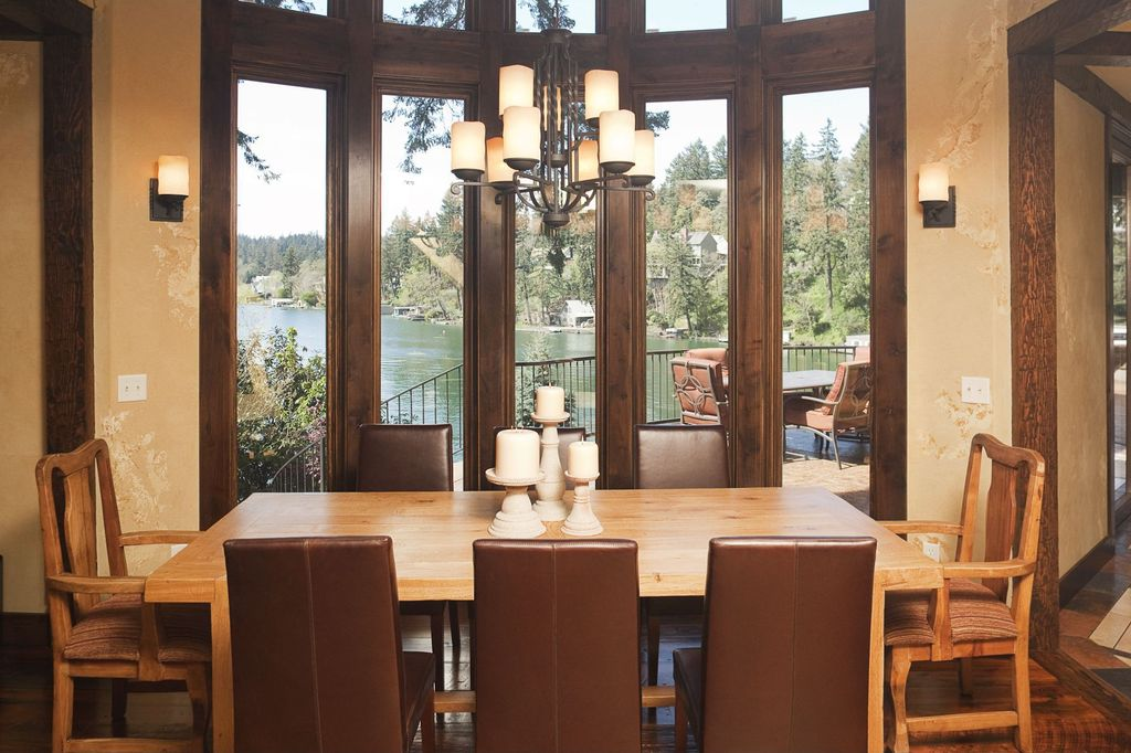 Craftsman Dining Room With Hardwood Floors Chandelier High Ceiling Wall Sconce Interior