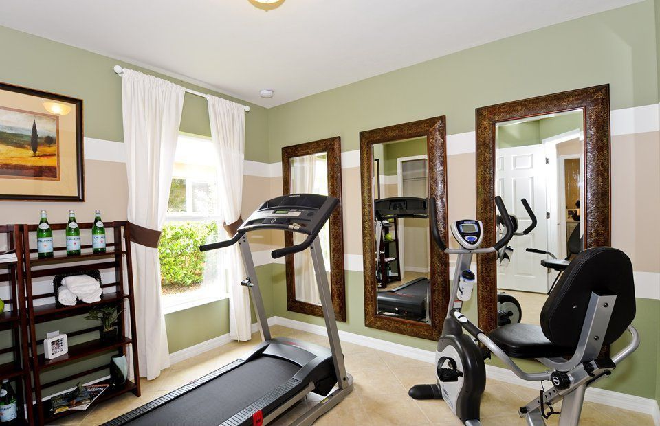 Home gym with flush light high ceiling zillow digs zillow Home fitness room design ideas