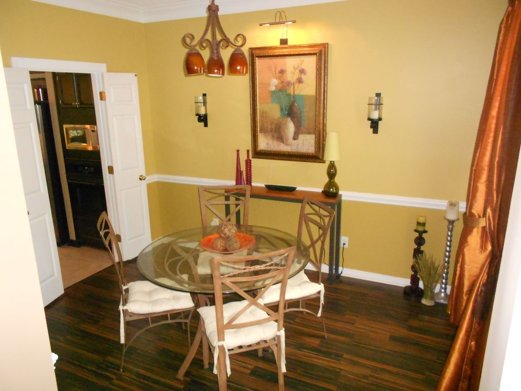 eclectic dining room with hardwood floorsmissyeirls | zillow