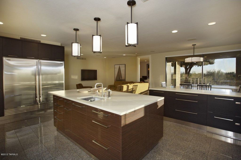 contemporary kitchen with pendant light flush kitchen island dekton ultracompact surface countertop