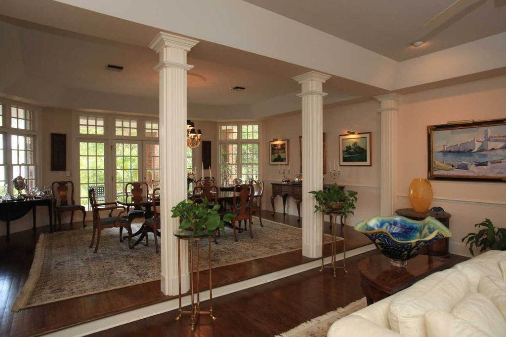 Traditional great room with high ceiling columns in for Living room columns