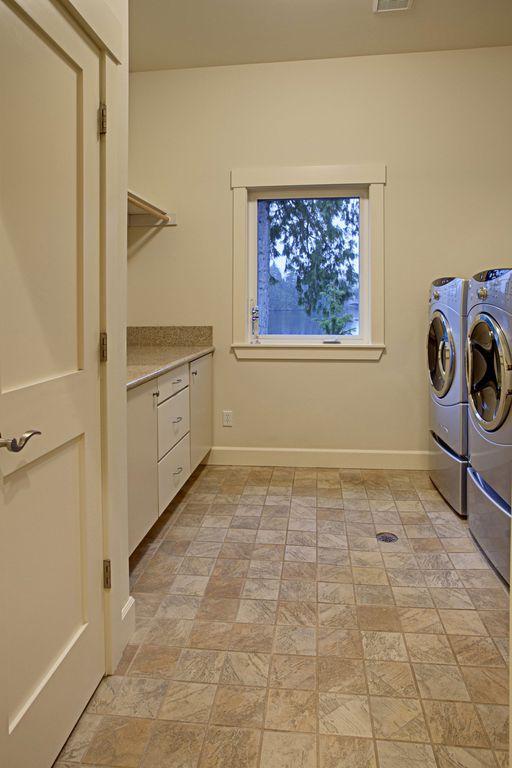 craftsman laundry room with ivc bandini 939 lowgloss finish sheet vinyl travertine floors