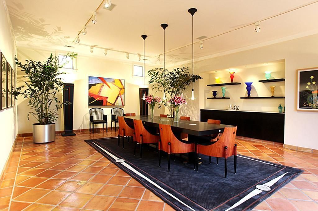 Modern Dining Room With Carpet Terracotta Tile Floors Pendant Light Built In