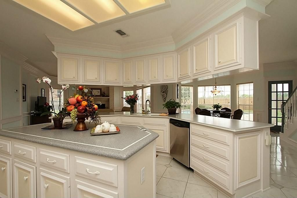 Traditional kitchen with raised panel drop in sink in for Kitchen island houston