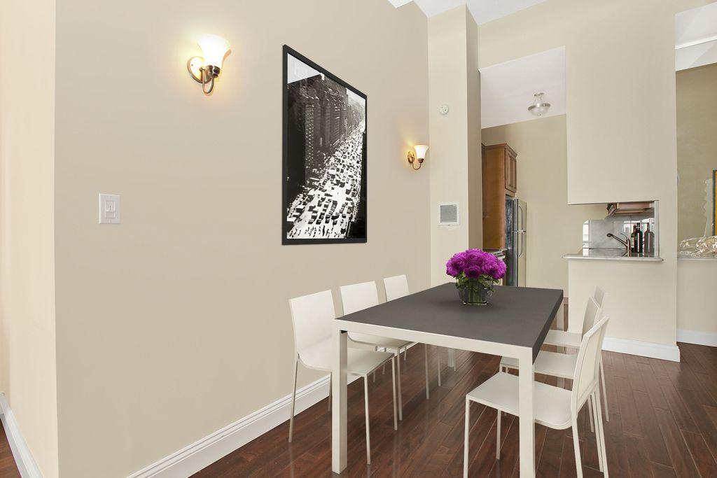 Modern Dining Room With Flush Light, Wall Sconce, Hardwood Floors