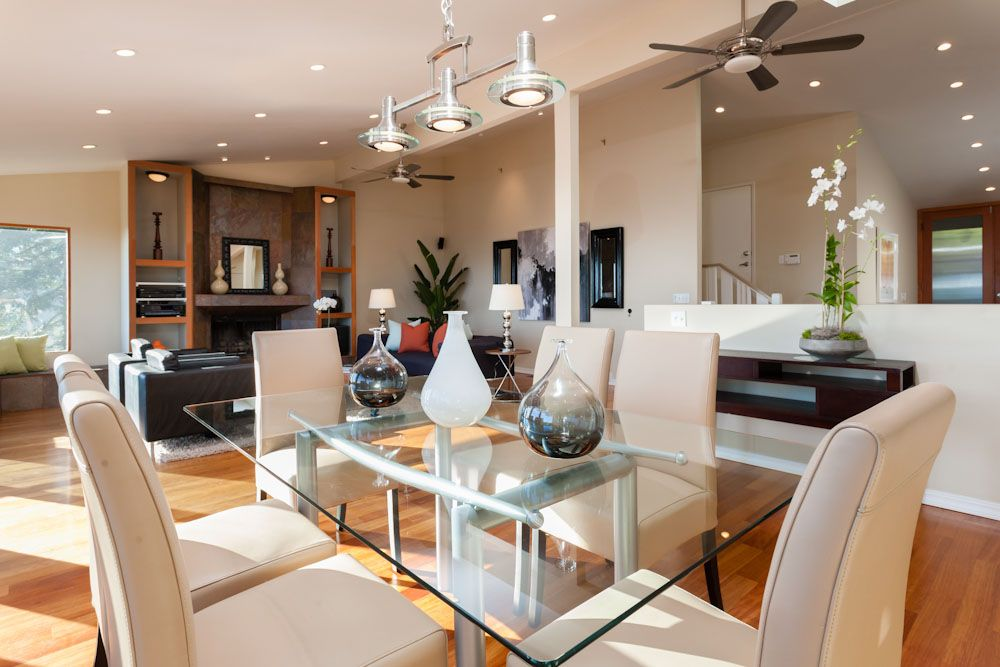 contemporary dining room with pendant light & hardwood floors in