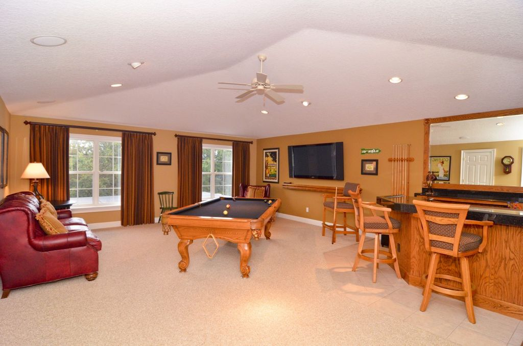 Traditional Game Room With Carpet, Ceiling Fan, Limestone Tile Floors, High  Ceiling,