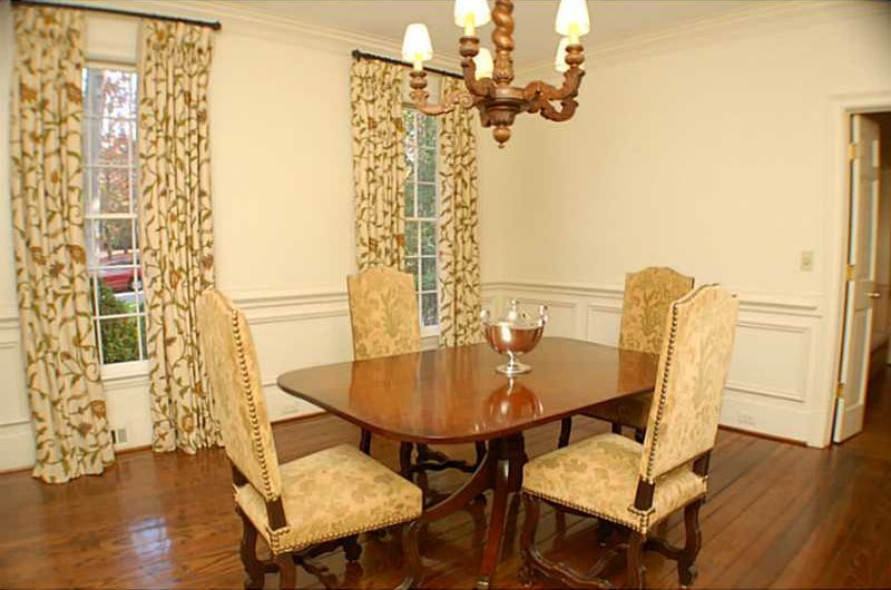 Traditional Dining Room With Wainscoting Chandelier Crown Molding Chair Rail Hardwood Floors