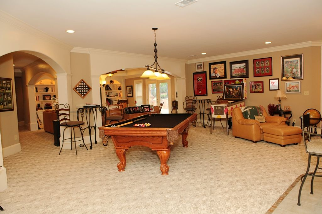 Game Room Flooring : Traditional game room with pendant light limestone tile