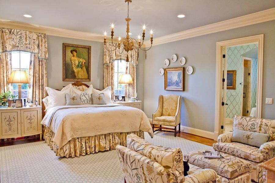 traditional master bedroom with chandeliereric ross interiors