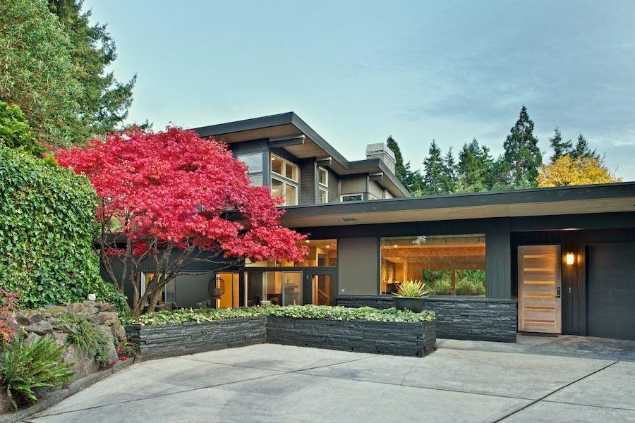 contemporary exterior of home with exterior tile floors exterior stone floors exterior brick siding