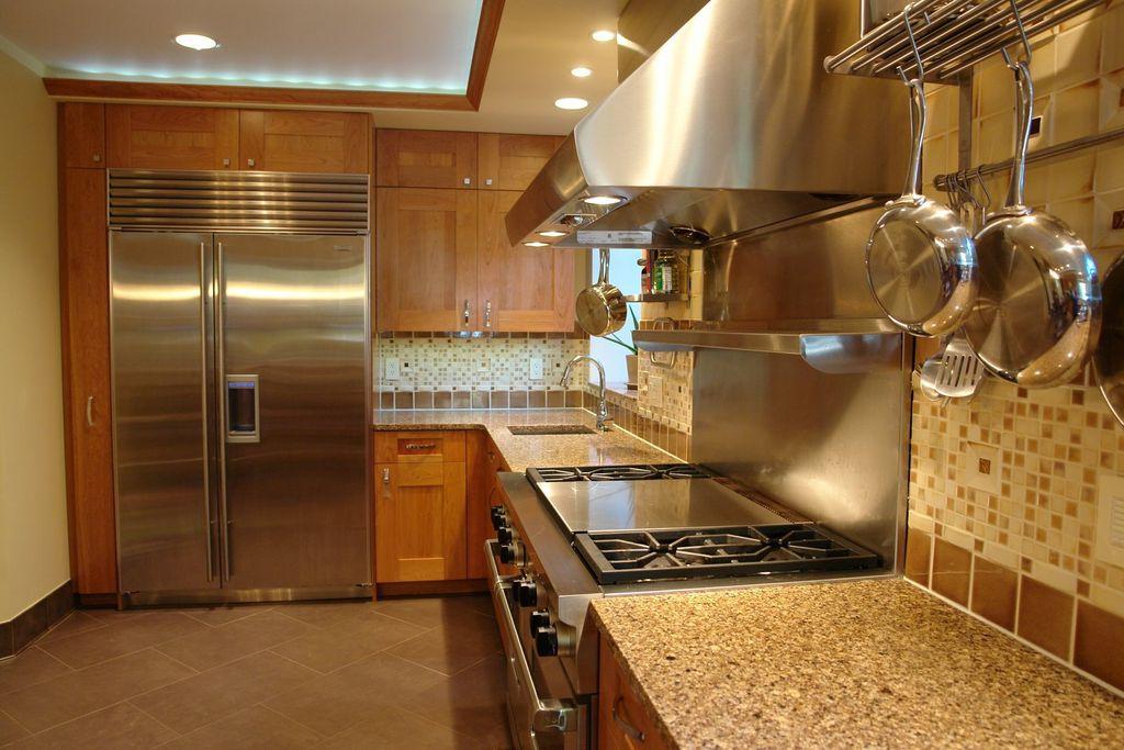 Craftsman Kitchen With MS International Java Cream Linestone, Amber Yellow  Granite Countertop
