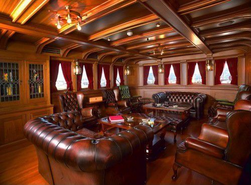 Traditional Living Laminate Flooring traditional living room with stone fireplace bear mountain ledge stone laminate floors built Traditional Living Room With Chair Rail Wall Sconce Exposed Beam Laminate Floors