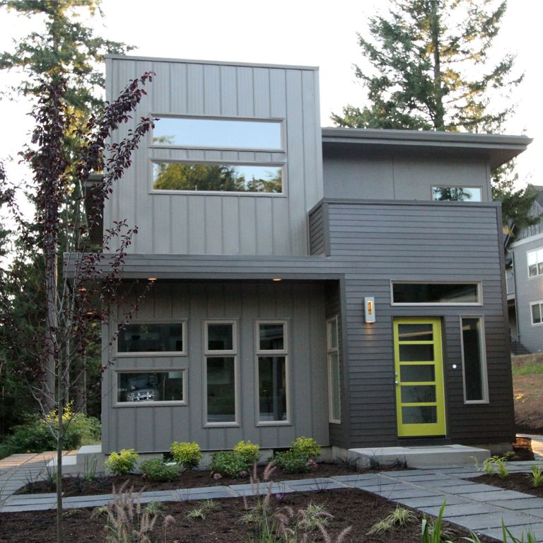 Modern exterior of home with french doors by jordan for Home front tiles design