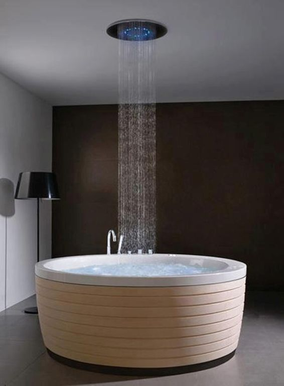 master bathroom with spun light f floor lamp porcelanosa soleil round tub round - Ceiling Shower Head